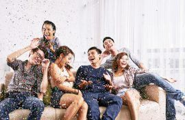 Group of Asian friends having fun at home party - FWD Home Insurance